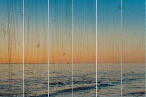 Zeilboot bij zonsondergang